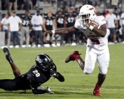(AP Photo/John Raoux). Florida Atlantic running back Devin Singletary (5) slips past Central Florida defensive back Brandon Moore (20) for a 9-yard touchdown run during the first half of an NCAA college football game, Friday, Sept. 21, 2018, in Orlando...