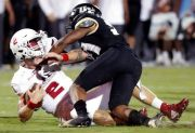 (AP Photo/John Raoux). Florida Atlantic quarterback Chris Robison, left, is hit by Central Florida defensive back Rashard Causey after a short run during the first half of an NCAA college football game, Friday, Sept. 21, 2018, in Orlando, Fla.