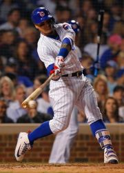 (AP Photo/Jim Young). Chicago Cubs' Javier Baez hits a single against the Pittsburgh Pirates during the sixth inning of a baseball game Monday, Sept. 24, 2018, in Chicago.