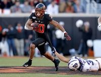 Oklahoma State RB Chuba Hubbard says he won't participate in workouts due to coach Mike Gundy's OAN shirt