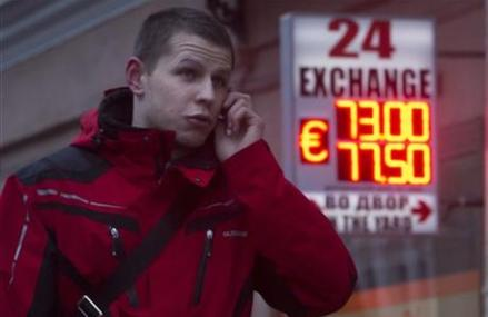 What the credit downgrade to 'junk' means for Russia