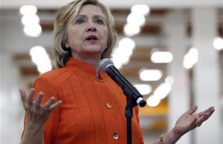 Clinton seeks distance from Obama on climate change issues