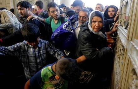 The Latest: Hungarian PM says migrant crisis is German issue