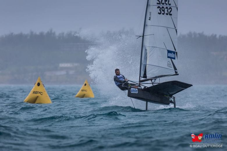 Tom Loughborough kicks up a tower of spray during windy action on Great Sound.