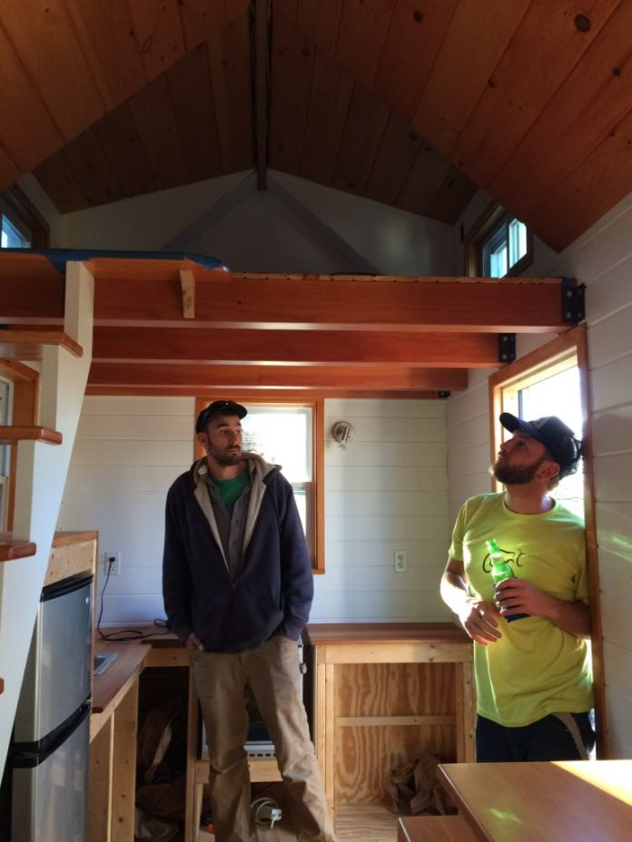 Sam Leuschner (left) and Andrew Croan (right) inside the Tiny Home they constructed.