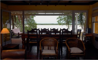 dining room with a water view