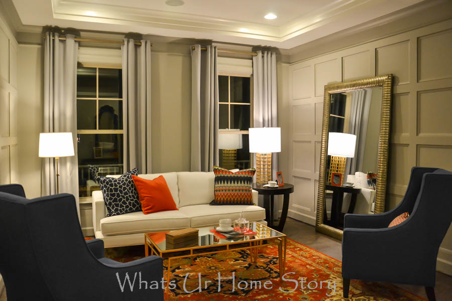 Transitional living room with pops of orange