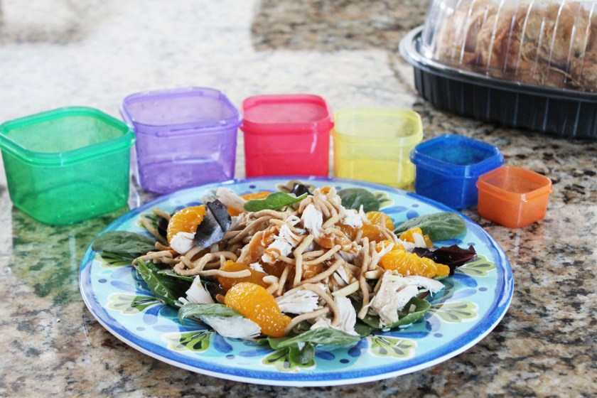 chinese chicken salad with containers and rotisserie chicken