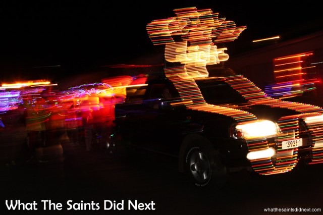 Leading the parade, the Festival of Lights sign vehicle