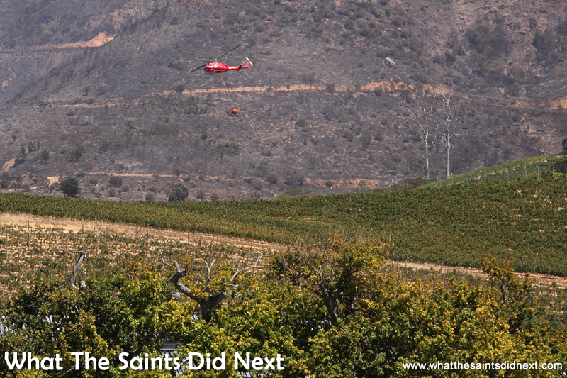 Constantia wine farms under threat as helicopters fight to control wildfires.