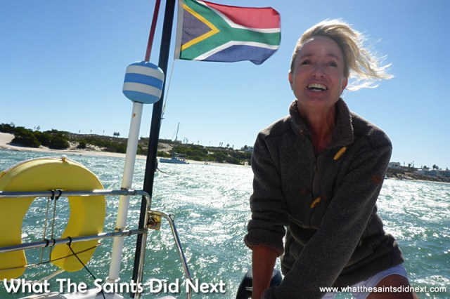 Diane taking a turn at the helm as we set off, sailing St Helena Bay.
