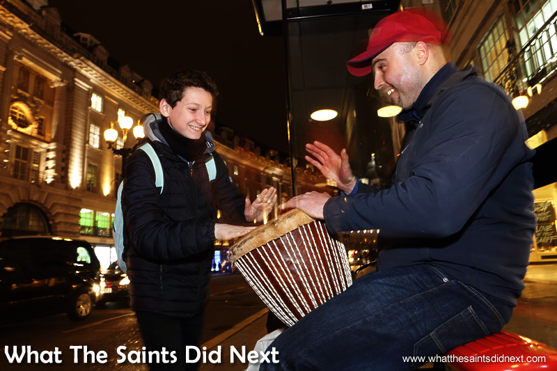 Another youngster is drawn in by the music and once again Dan allows him to have a go on the drum.  Homeless Bucket Drum Busker Living On The Streets Of London.