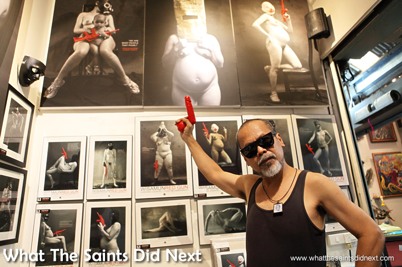 Wisamunmuang Sitthiket himself with his red gun art nudes.