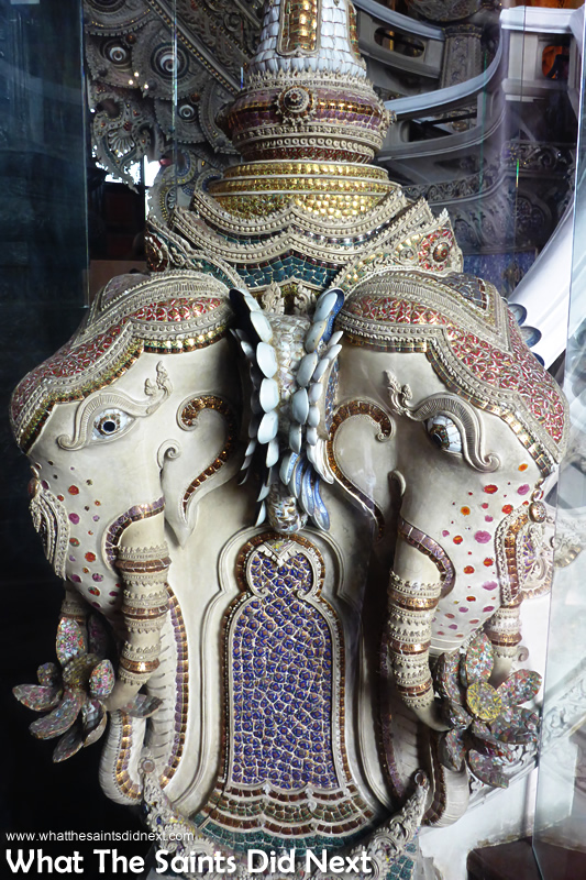 Discover what do elephants represent at Erawan. This Airavata elephant statue has so much detail. Notice the ears made of spoons.
