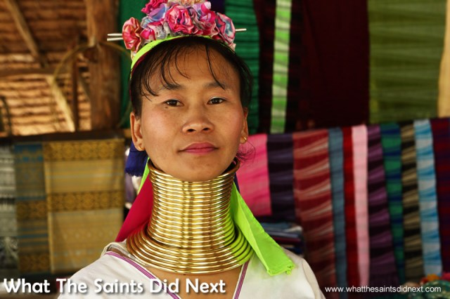 A Karen Long Neck Lady wearing the neck coils.