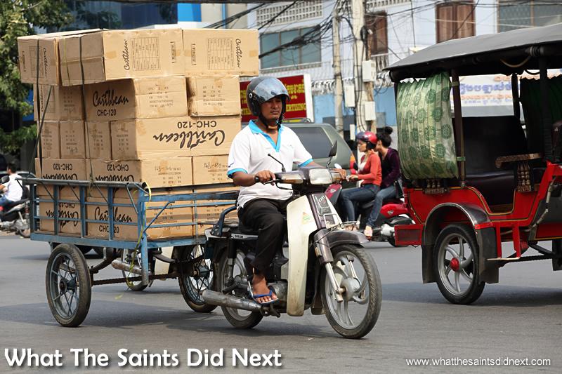 One of Phnom Penh's dedicated cargo tuk tuks. Watching Cambodia Traffic.