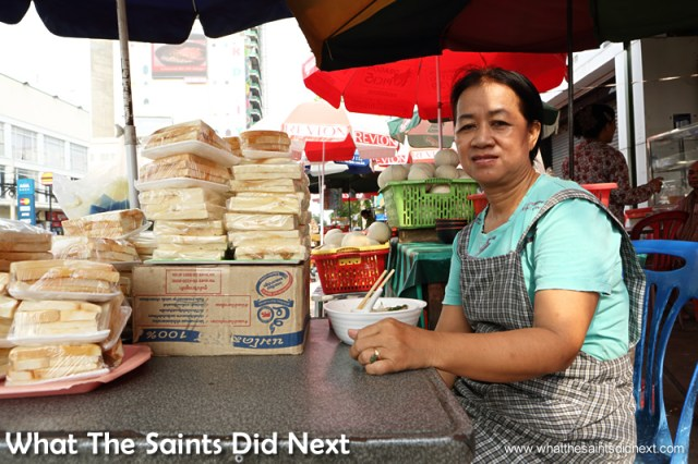 This street seller kindly allows us to photograph her. Our first time in Phnom Penh exploring the city.