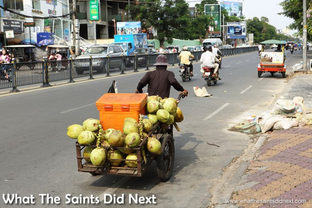 This street seller pulls his own car loaded with fruit. Walking The Streets Of Phnom Penh.