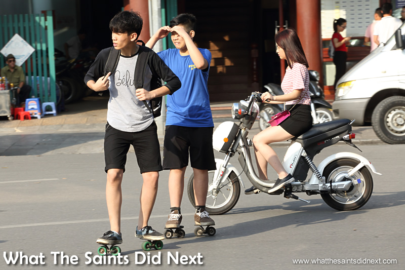 These boys on side-ways roller skates just make the whole process even more confusing! Crossing The Street In Hanoi Vietnam.