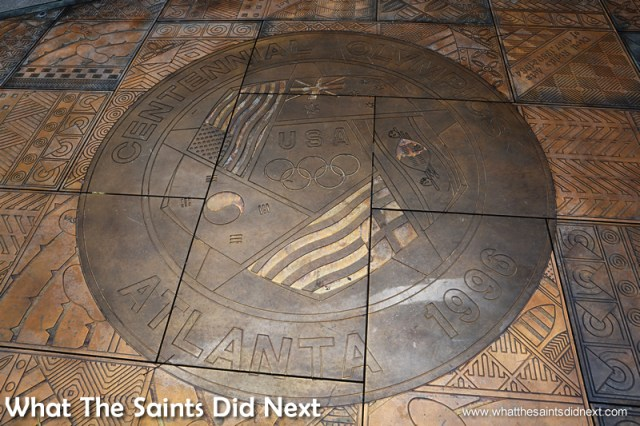 The Olympic tributes are part of the bronze floor around the Andrew Young Plaza.