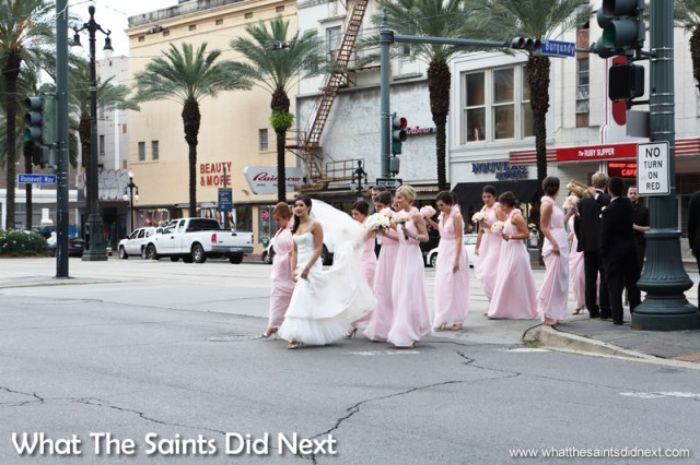 Early evening light brings a wedding party out on Canal Street for photographs.