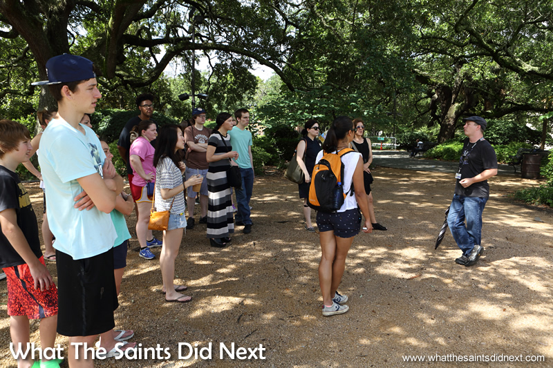 Learning about the New Orleans religion, standing under the shade of trees in Congo Square, the place where Voodoo began.