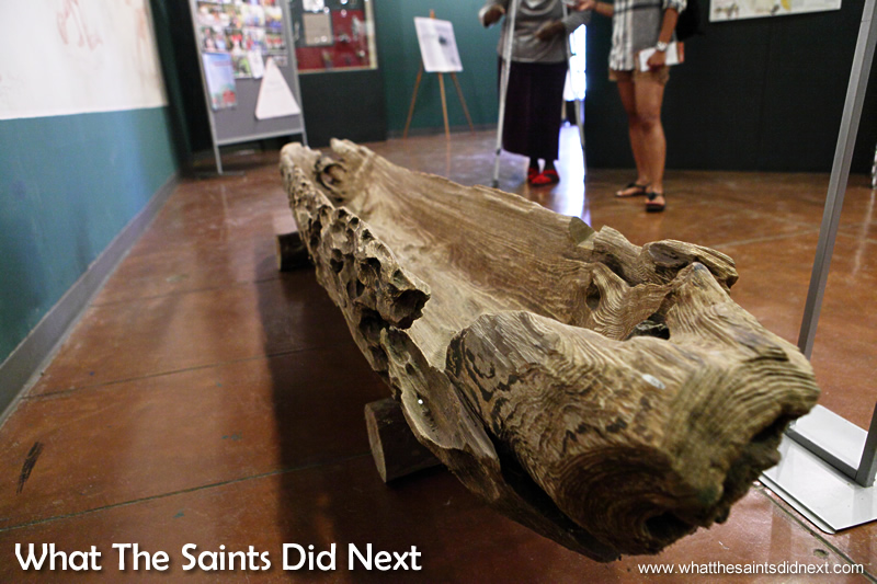 A primitive dugout canoe made of cypress wood which dates back to 1200-1300 AD. It was found 50 feet underground by the highway authority.