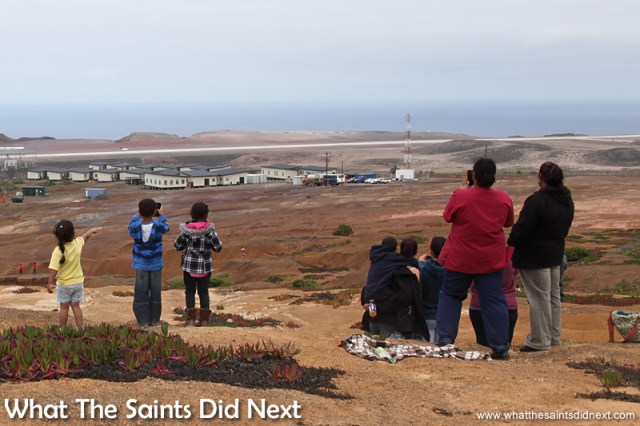 Youngsters watching the moment the first aeroplane to land on St Helena touched down from afar.