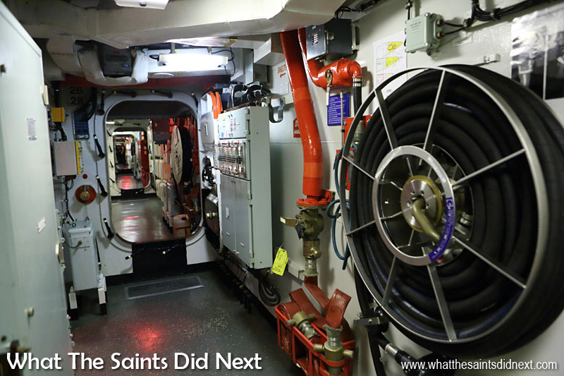The Lancaster's alleyways and different sections of the ship can be closed off into sealed compartments with large steel doors. No fancy cable ducts or panelling aesthetics, everything is exposed and accessible for easy repair or maintenance. The red piping carries water for fire fighting (salt water).