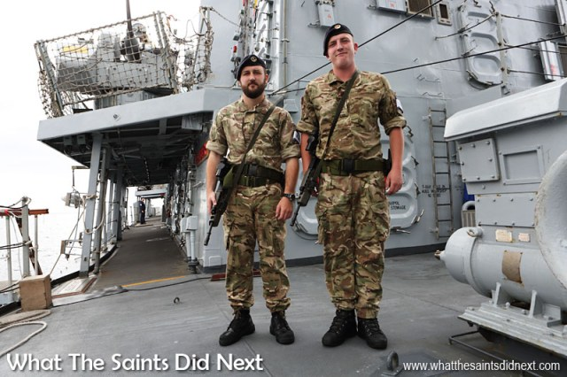 Armed guards at the top of the gangway is standard for HMS Lancaster, whether tied up alongside or anchored in the bay.