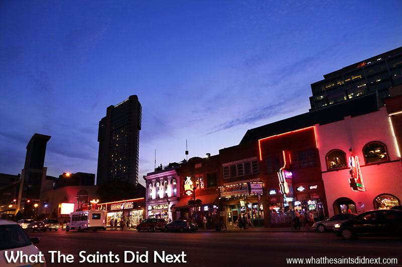 Downtown Nashville bars, Broadway Street as night is falling.