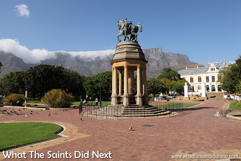 Canon 5D-MKII: 09:37, 1/250, f/14, ISO-200 Start of summer in Company Gardens, Cape Town, South Africa. The monument shadow is falling away to the right but even at 9:37am the light is already becoming intense. The blue sky with the 'table cloth' cloud over Table Mountain in the background was a lovely bonus for this shot.