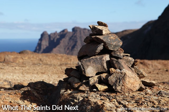Canon 5D-MKII: 16:19, 1/320, f/8, ISO-100 Landscape Photography Tips - A cairn of rocks marking the post box walk to Cox's Battery on St Helena. Shadows work brilliantly here to bring out the sharp shapes of the rocks and highlight the surface patterns.