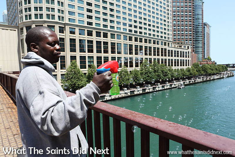 Homeless in Chicago - Andre finds this simple technique to lifting people's spirits is a great way to earn money.