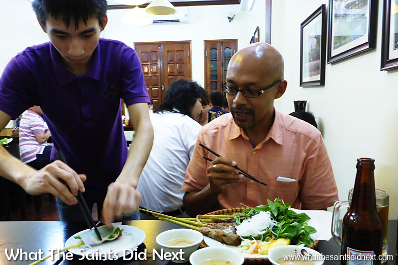 Our waiter demonstrating how to prepare Hanoi Spring Rolls. From this moment on in Vietnam, spring rolls were my thing!