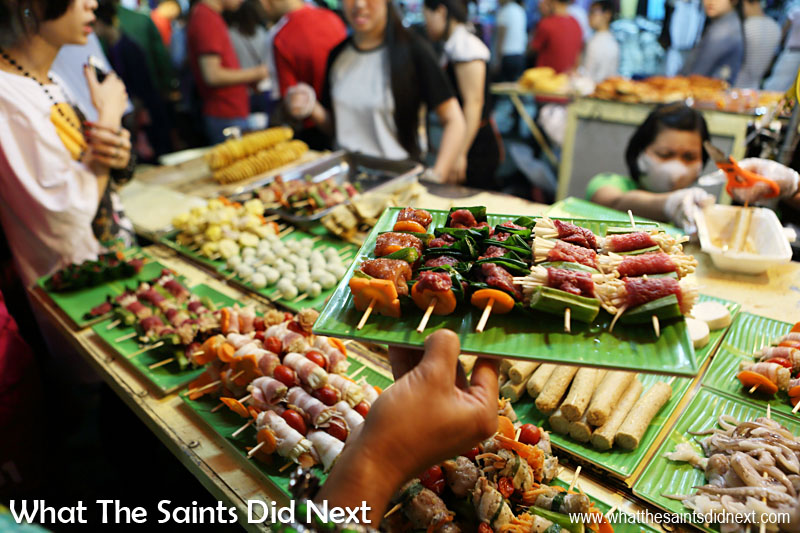 Fast food with a difference in Hanoi, Vietnam - this is healthy, fresh and very, very tasty. This street food stand was part of the night market in Hàng Đào street, Hanoi. Customers can choose their own skewer selection then hand over their tray for it to be cooked. Fantastic experience all round.