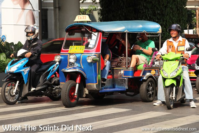 Tuk tuks and scooters are the camels of Southeast Asia. In Thailand and Cambodia especially we rode tuk tuk taxis nearly every day. The tuk tuks in Cambodia are different; a scooter pulling a trailer. In Bangkok the scooter is more built in to the tuk tuk, as shown in this picture.