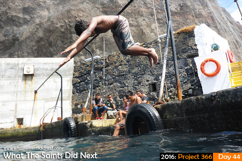 'Mobile' 13 Feb 2016, 14:58 - 1/640, f/3.3, ISO-100 What The Saints Did Next - 2016 Project 366 Kids swimming off the Jamestown wharf steps on St Helena.