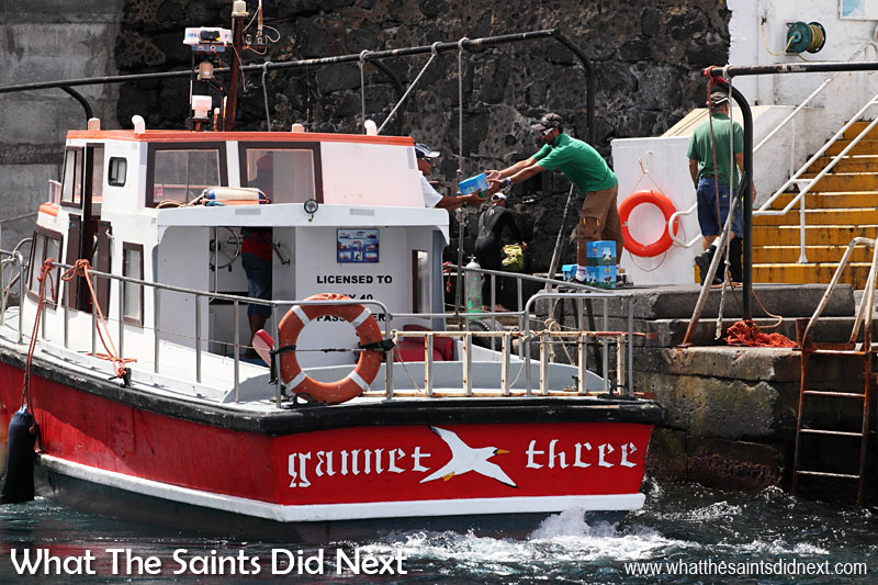 The 'Gannet Three' launch loading food supplies at the wharf in Jamestown, St Helena, to be delivered to Skandi Admiral.