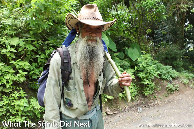 Raymond Isaac, (nicknames: 'Jesus' and 'Sandy Bay') works on a banana plantation in Sandy Bay.