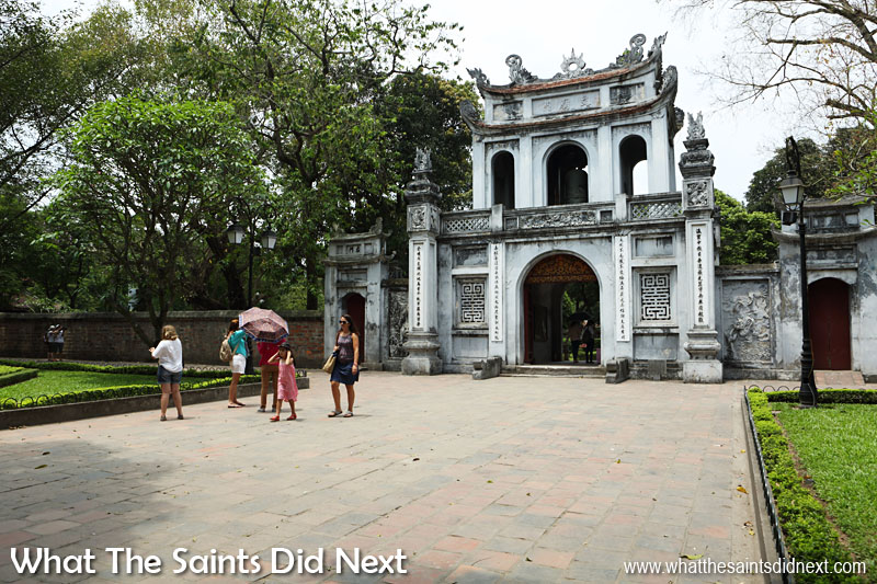 The 'Four Pillars' gateway into Quoc Tu Giam (Temple of Literature) in Hanoi, Vietnam.  The temple was built in 1070 and has had reconstruction and restorations throughout the proceeding centuries.