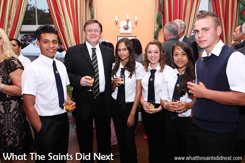 Hosting the annual party at Plantation House to celebrate the Queen's birthday. Governor Mark Capes pictured here with some of the Prince Andrew School students who were invited. 19 April, 2013.