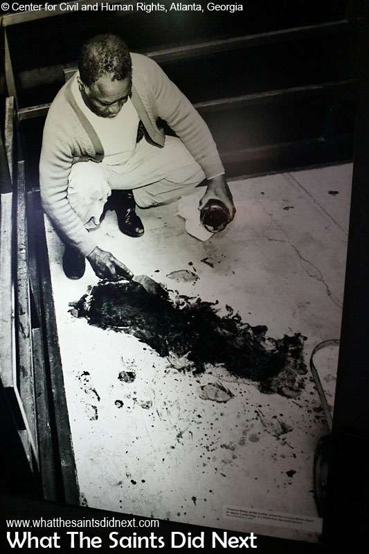 Dr Martin Luther King Jr's blood being cleaned off the Lorraine Motel balcony in Memphis, Tennessee, after he was shot and killed on April 4, 1968. (photograph displayed in Center for Civil and Human Rights, Atlanta, Georgia)
