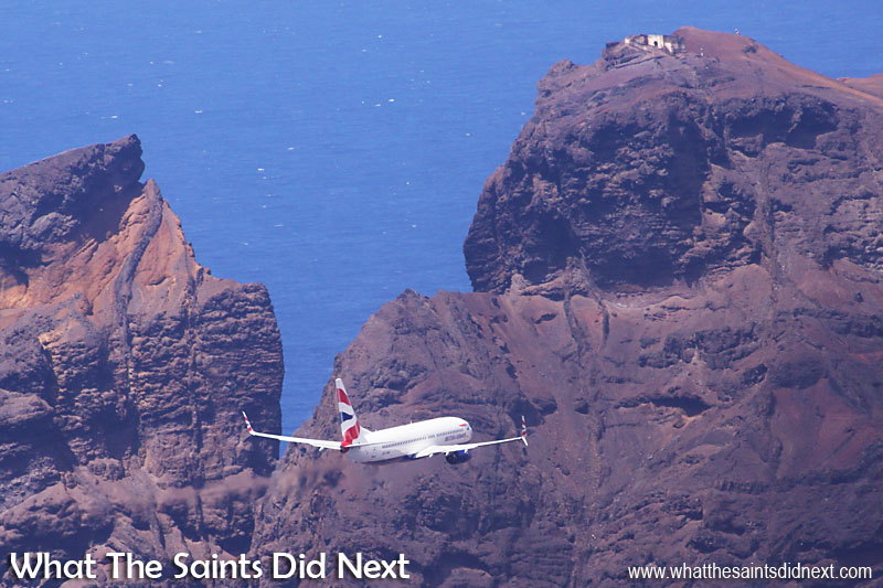 Comair / British Airways 737-800 Landing On St Helena. First approach, flying in for a low-level pass over the new St Helena Airport, below the ruin of Prosperous Bay House and King & Queen Rock.