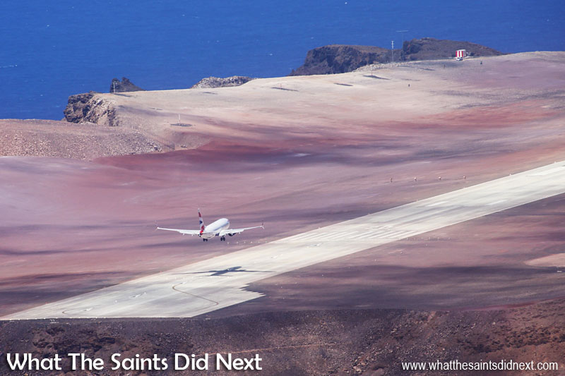 The Comair operated, British Airways Boeing 737-800 landing at the new St Helena Airport. The colourful earth and lunar terrain on Prosperous Bay Plain makes for a dramatic arrival scene for passengers.