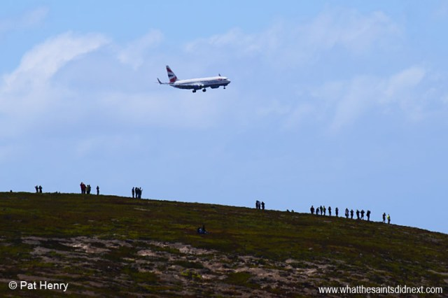 View from near the Millennium Forest of the Comair operated, British Airways Boeing 737-800 on final approach to the St Helena Airport, with spectators on the top of Horse Point. Photo courtesy of Pat Henry.
