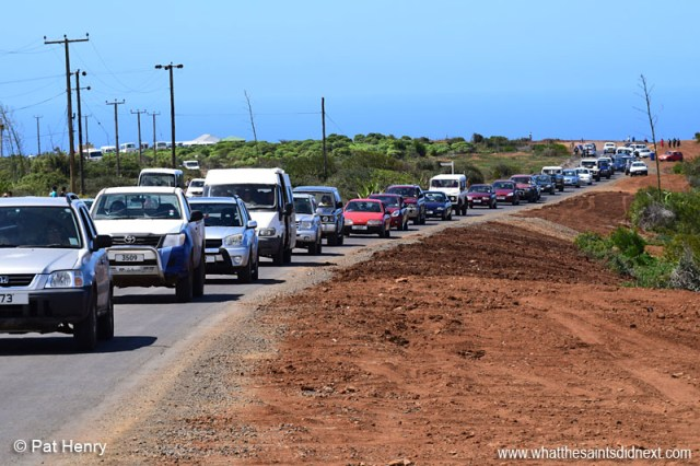 Hundreds of islanders turned out to witness the Comair operated, British Airways Boeing 737-800, land at St Helena Airport. This the long line of vehicles leaving on the Bottomwoods Road after the event. Photo courtesy of Pat Henry.