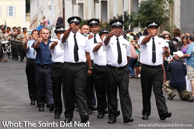 Uniformed groups, including the St Helena Police, marched down Main Street to the tune of the Scout band. Inauguration Ceremony of Her Excellency the Governor, Ms Lisa Phillips - Supreme Court Terrace, Jamestown, St Helena.