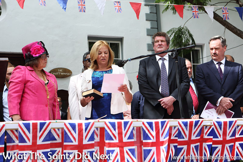 The Island's new Sheriff, Mrs Ethel Yon, administers the Oaths of Office to the Governor Designate. Also on stage, Head of the Governor's Office (Acting Governor), Sean Burns and Chief Secretary, Roy Burke (far right). Inauguration Ceremony of Her Excellency the Governor, Ms Lisa Phillips - Supreme Court Terrace, Jamestown, St Helena.