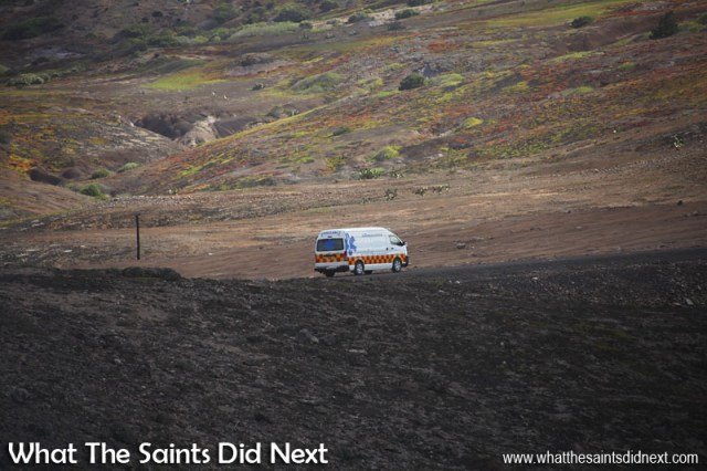ER24 medical team on board, the St Helena Airport ambulance begins the journey from the airport to the Jamestown hospital, driving through the rocky landscape of Prosperous Bay Plain.
